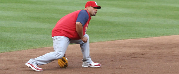Albert Pujols takes a ground ball