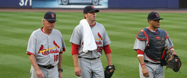 pitching coach Dave Duncan, starting pitcher Mitchell Boggs, and catcher Yadier Molina