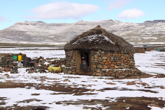 A Basotho homestead, on the plateau above Sani Pass, in winter by Adam Riley