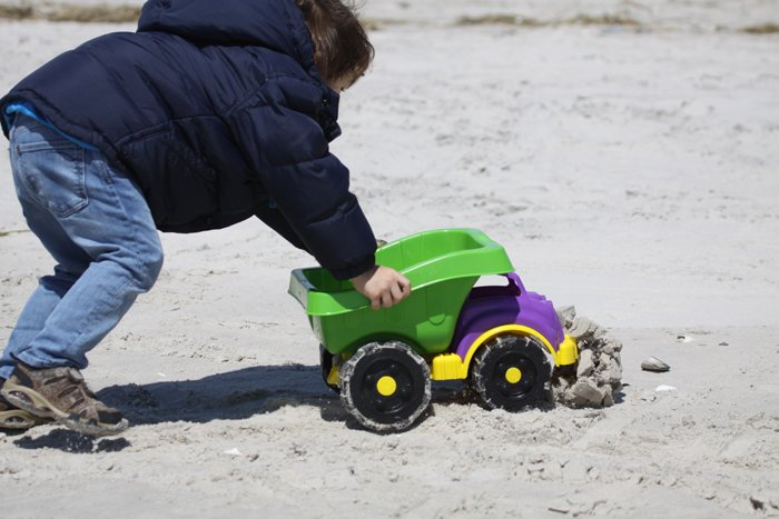 Desi smooshing a sand castle